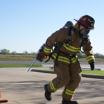 A firefighter during the physical agility test