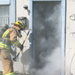 Firefighter enters home in fire training exercise