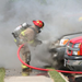 Firefighter extinguishing a vehicle fire